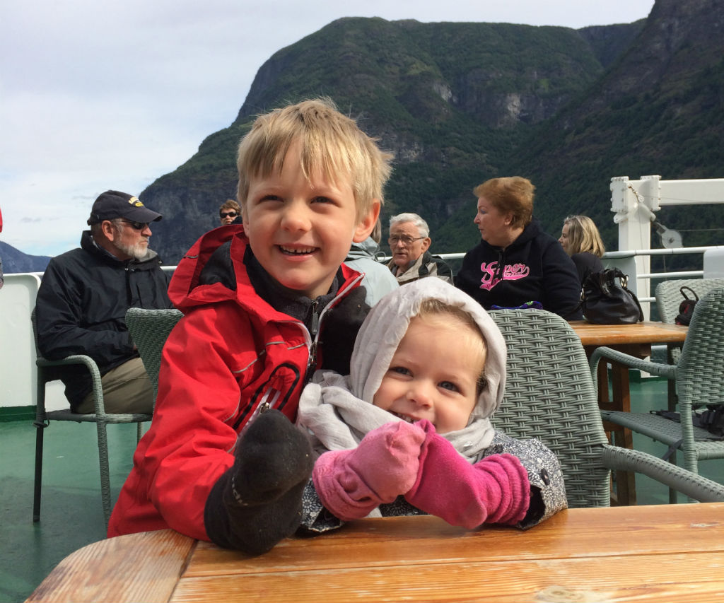 Toddler and a Child on the Ferry in Norway Fjords. Norway is great for kids.