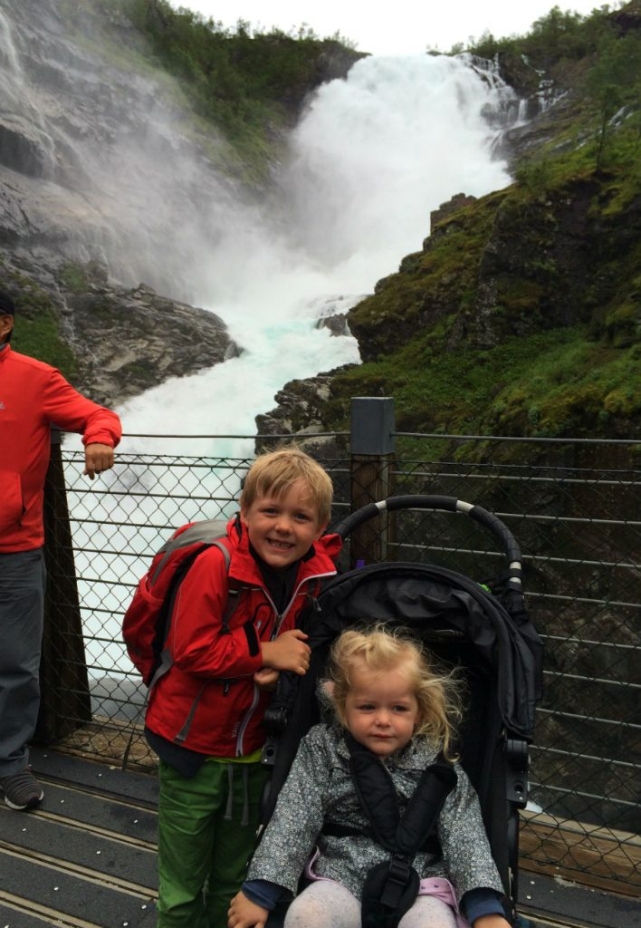 Norway in a Nutshell with kids. Enjoy stopping at a beautiful waterfall along the Flam Railway.