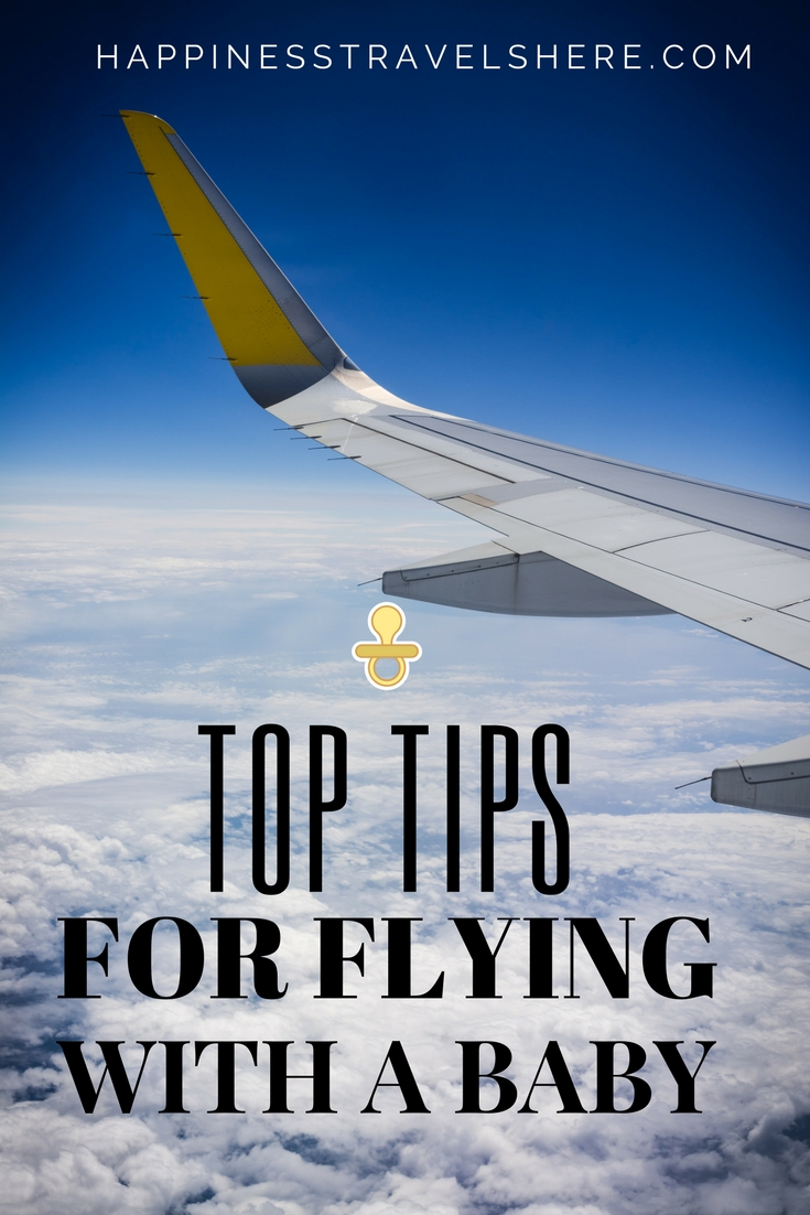 Family travelers share their top tips for flying with a baby. Happinesstravelshere.com