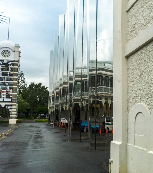 The mirrored fascade of the New Plymouth Attraction the Govett Brewster Gallery in downtown New Plymouth.