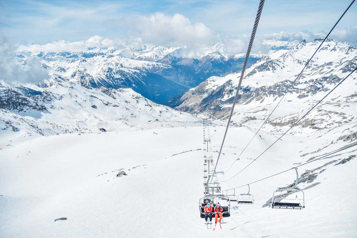 Chair lift up a snowy mountain, winter activities.