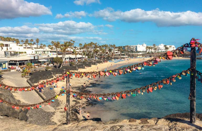 Playa Flamingo beach in Playa Blanca, Lanzarote. One of the best things to do in Playa Blanca is walk the promenade and visit the beaches that line the walk way.