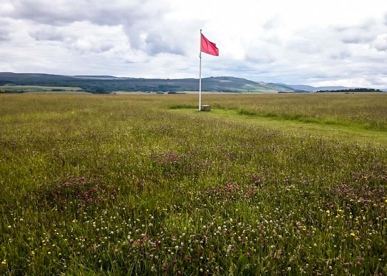 Red flag at Culloden Battle field. Where to visit in Scotland by car.