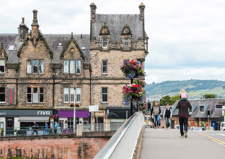 Walking across a bridge into Inverness Old Town Scotland