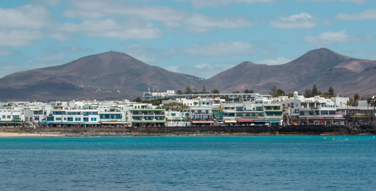 A view back to the Promenate that you can walk along in the town of Playa Blanca, one of the best places to visit in Lanzarote.