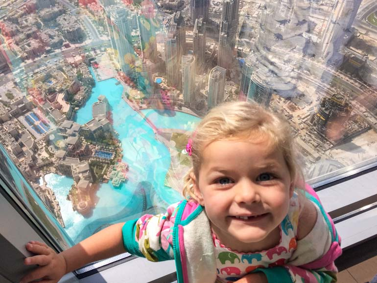Burj Khalifa with kids taking in the view of Dubai