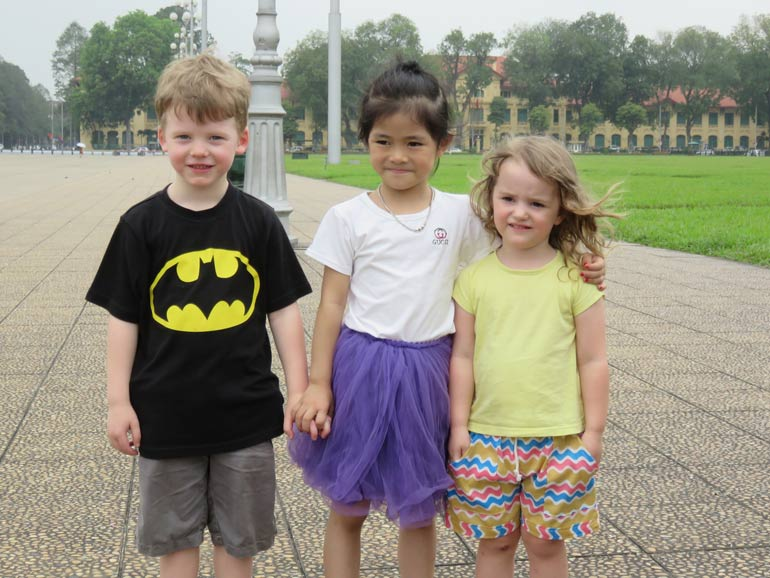 Kids making friends on family vacation in Hanoi Vietnam