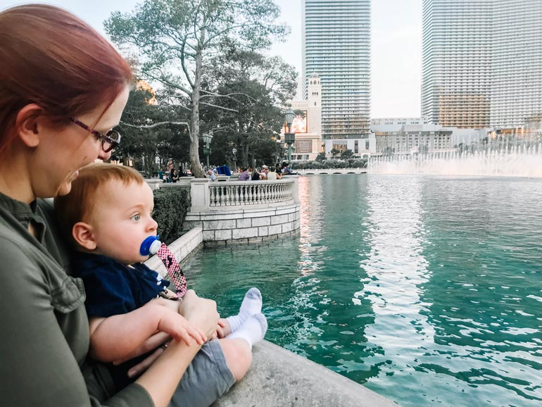 Mom watching the Bellagio fountains in Las Vegas with her baby