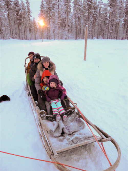 Family Holiday in Lapland going husky sledging with kids near Levi
