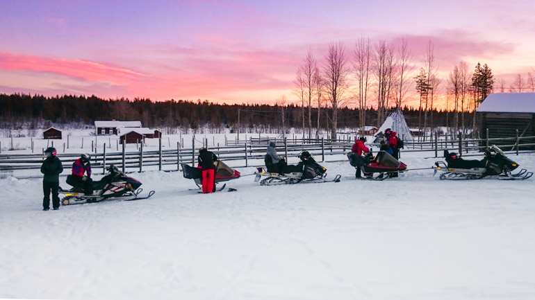 Beautiful purple and orange sky of Levi in Finland during Christmas.  Snow mobile ride to see Father Christmas in his North pole home.