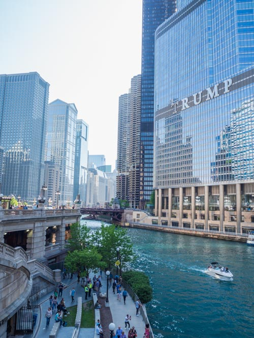View down the Chicago River with Trump tower on one side and river walkway on the other