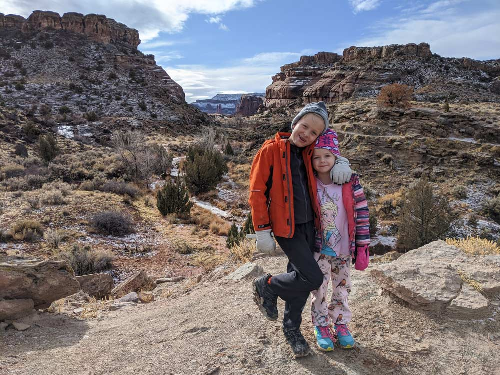 Kids dressed for a 3 day winter itinerary visiting Moab, Utah